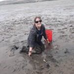 Colleen digging for native clams