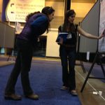 Allison explains her research to Maya at the Ocean Sciences Meeting in New Orleans